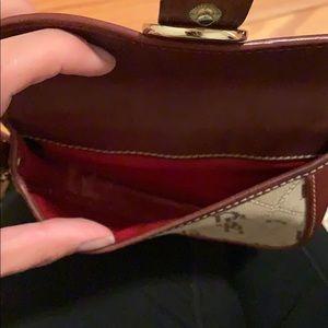 Dooney & Bourke Bags - Two Authentic Dooney & Bourke Wristlets
